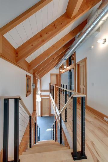 Exposed Douglas fir timber, a design choice made by the home owners to create a New England barn-like feel.